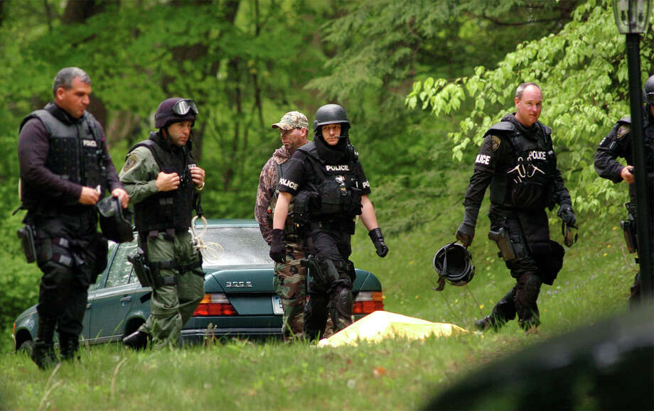 Police at the home on Dogwood Drive, in Easton, Conn. where Gonzalo Guizan was shot and killed by police during a raid on May 18th, 2008. Photo: Christian Abraham, Christian Abraham / Connecticut Post