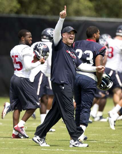 Houston Texans head coach Bill O'Brien starts up practice during Texans practice at the Methodist Tr