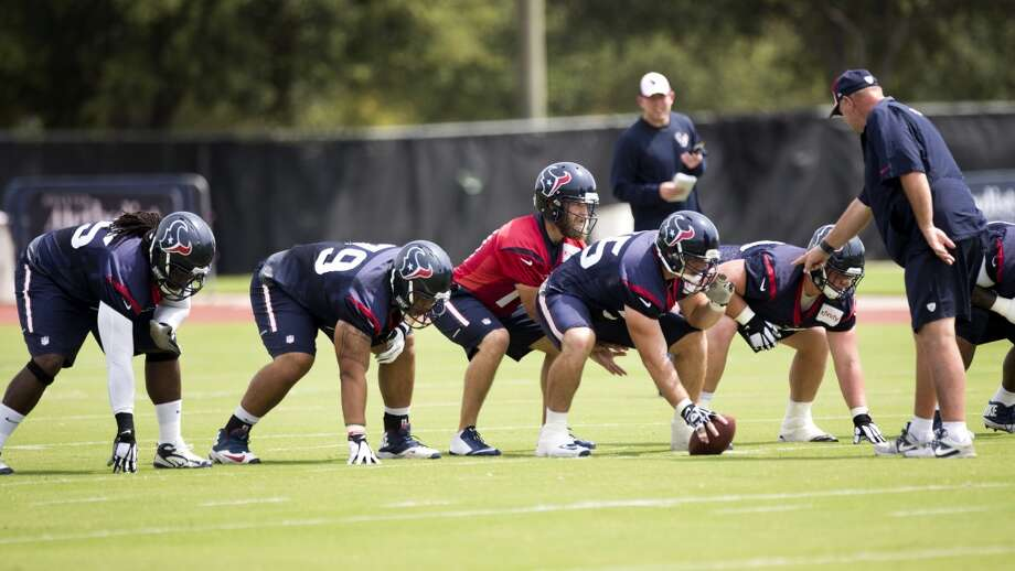 Houston Texans quarterback Ryan Fitzpatrick (14) lines up behind the Texans offensive line during Texans practice at the Methodist Training Center Monday, Aug. 25, 2014, in Houston.  ( Brett Coomer / Houston Chronicle ) Photo: Brett Coomer, Houston Chronicle