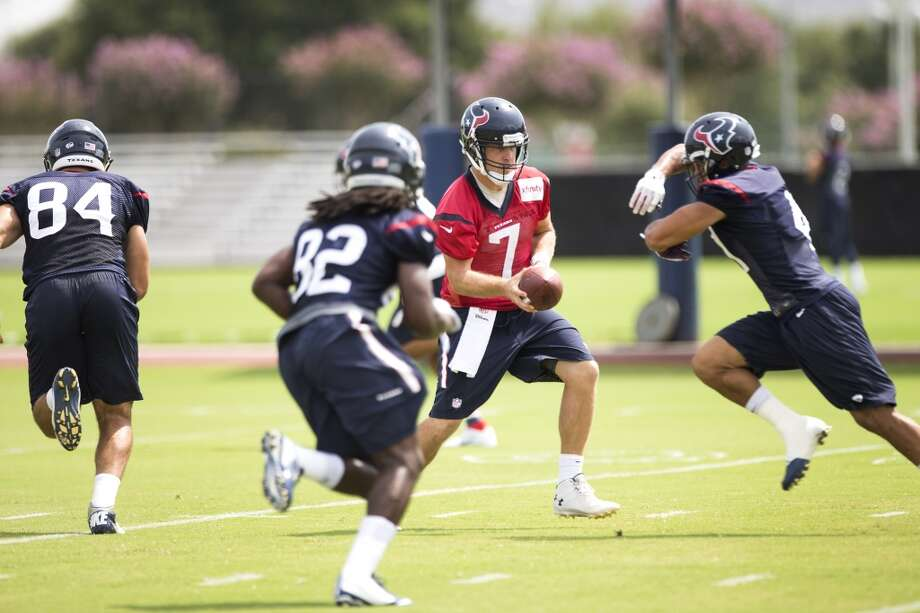 Houston Texans quarterback Case Keenum (7) runs a play during Texans practice at the Methodist Training Center Monday, Aug. 25, 2014, in Houston.  ( Brett Coomer / Houston Chronicle ) Photo: Brett Coomer, Houston Chronicle
