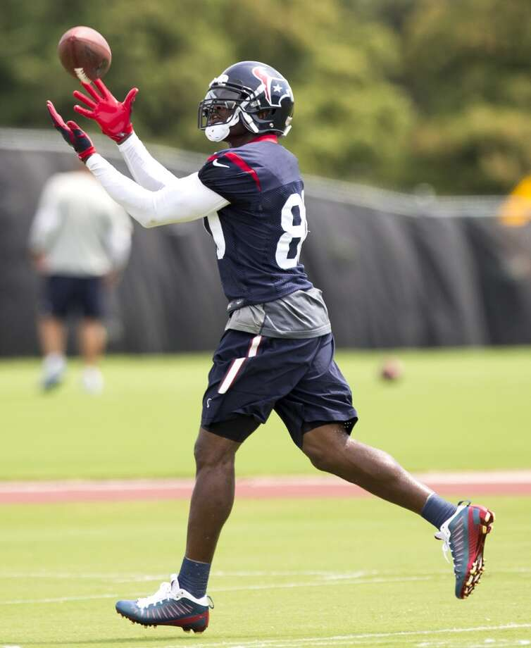 Houston Texans wide receiver Andre Johnson reaches out to make a catch during Texans practice at the Methodist Training Center Monday, Aug. 25, 2014, in Houston.  ( Brett Coomer / Houston Chronicle ) Photo: Brett Coomer, Houston Chronicle