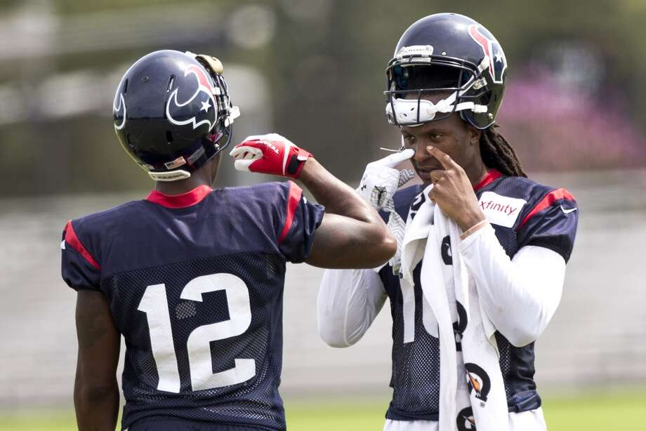 Houston Texans wide receivers Lacoltan Bester (12) and DeAndre Hopkins (10) take a break between drills during Texans practice at the Methodist Training Center Monday, Aug. 25, 2014, in Houston.  ( Brett Coomer / Houston Chronicle ) Photo: Brett Coomer, Houston Chronicle