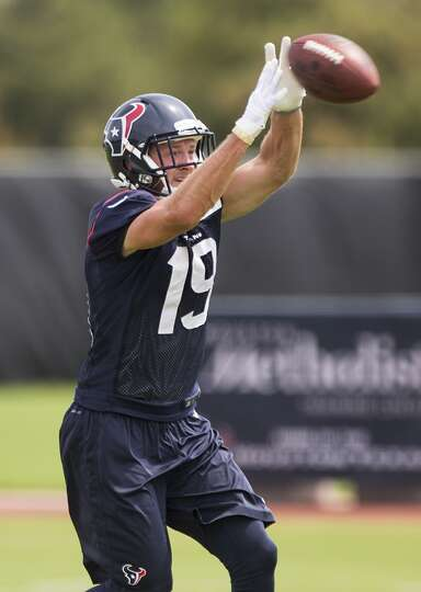 Houston Texans wide receiver Travis Labhart reaches up to make a catch during Texans practice at the