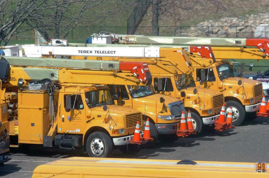 Connecticut Light and Power trucks in the Greenwich High School parking lot where CL&P is running a satelite office to serve as a hub for line crews working in north Greenwich Friday afternoon March 19, 2010. There are more than 100 crews from as far away as Canada and Pennsylvania working to restore power and traffic routes throughout town after last weekend's storm. Photo: Keelin Daly, ST / Greenwich Time