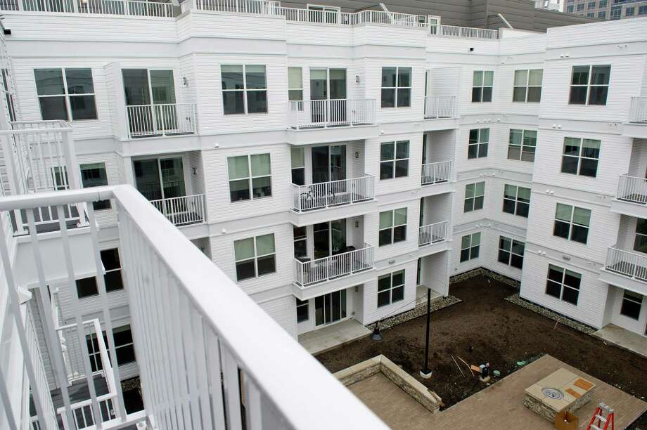 Apartments at 75 Tresser Blvd. in Stamford, Conn., seen from a balcony over the nearly completed fire pit courtyard on Thursday, May 22, 2014. Photo: Lindsay Perry / Stamford Advocate