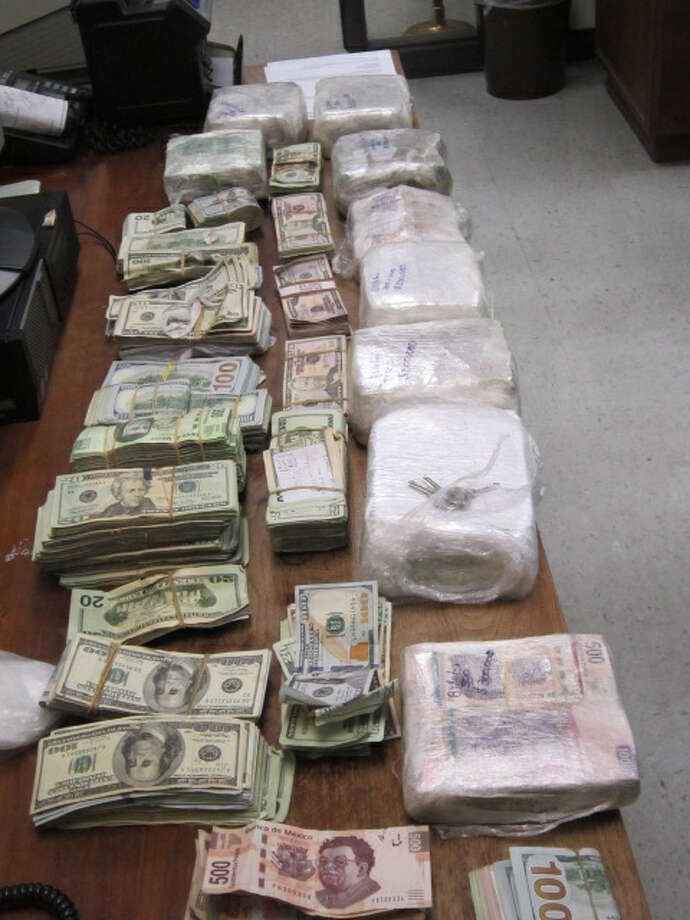 Four abandoned backpacks found by U.S. Border Patrol agents in the Rio Grande Valley Thursday contained more than $650,000 in cash and a kilogram of cocaine.To see some of the biggest Texas drug busts, click through the slideshow. Photo: Courtesy
