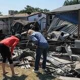 Residents inspect fire damage at the Napa Valley Mobile Home Park, where several homes were destroyed Sunday.