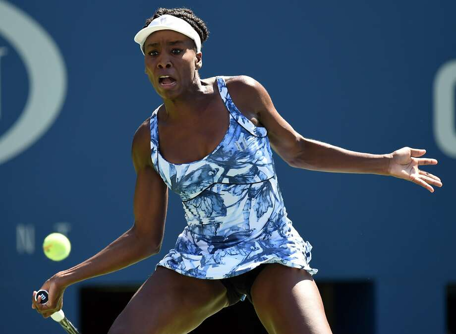 No. 19 seed Venus Williams returns a shot in her first-round victory over Kimiko Date-Krumm at the U.S. Open. Williams will play unseeded Timea Bacsinszky in the second round. Photo: Don Emmert, AFP/Getty Images