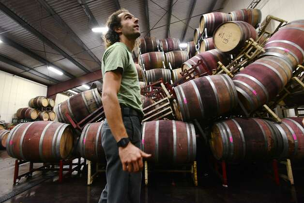 Associate winemaker Andrew Brooks of Bouchaine winery in Napa working on the clean up in Bouchaine's barrel room from Sunday morning's 6.0 earthquake. The quake left the barrel room ankle deep in wine when employees first came to assess the damage. August 25, 2014. Photo: Erik Castro, Special To The Chronicle