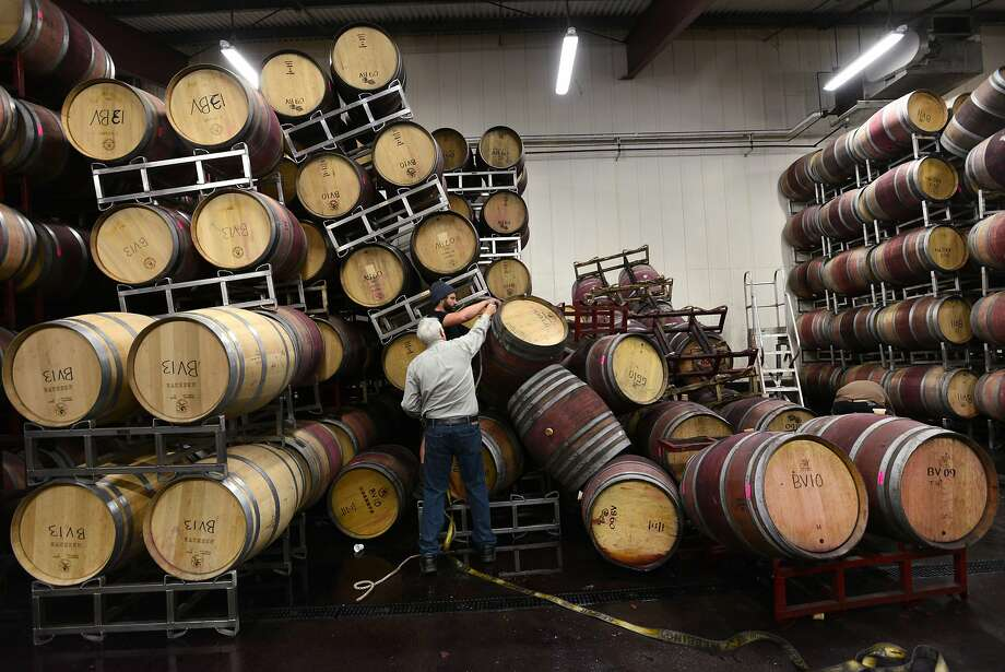 General manager and head winemaker Michael Richmond (front) of Bouchaine Vineyards in Napa works on cleanup in the barrel room with assistance from Alex Westerberg of Healdsburg's Roth Estate Winery. Photo: Erik Castro, Special To The Chronicle