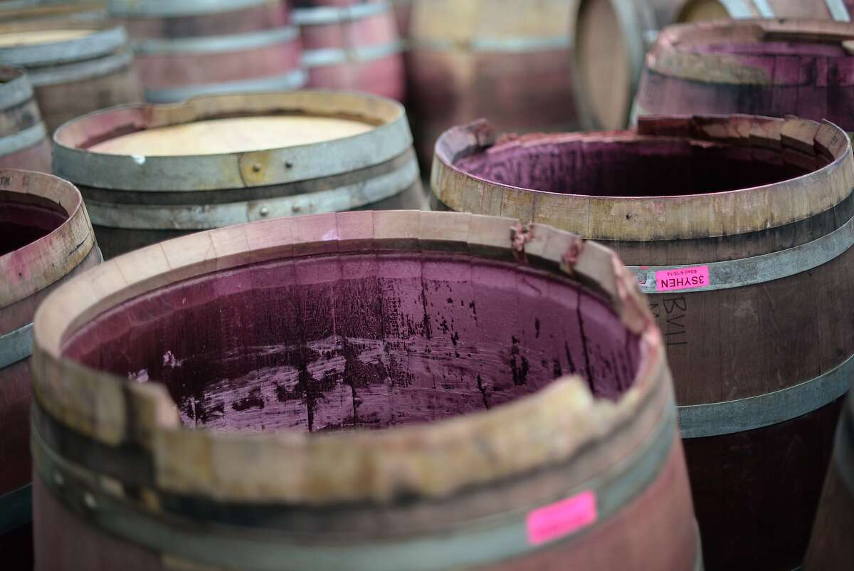 Damaged wine barrels were removed from Bouchaine winery in Napa this morning as part of the clean up after Sunday morning's quake. August 25, 2014.