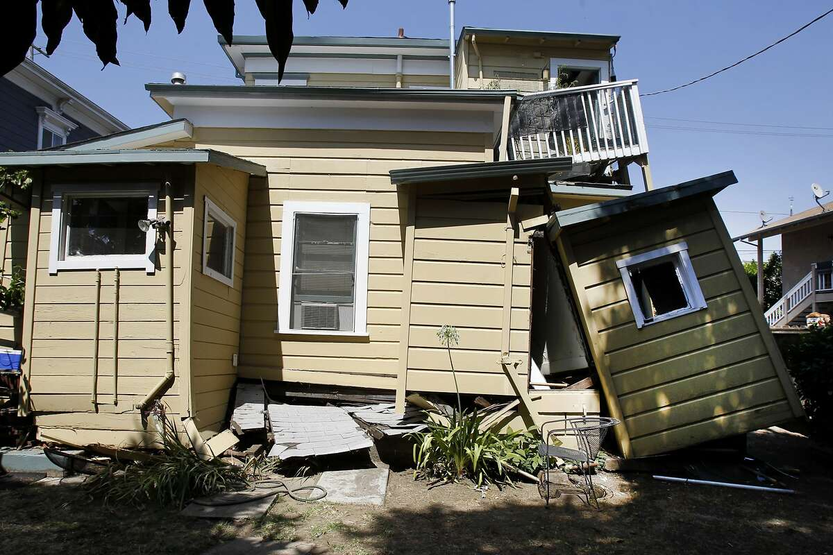 The backyard side of a home on Fourth Street near downtown Napa, Calif shows how if fell off its foundation in the quake. Residents and shop owners in Napa, Calif. spent the day cleaning up or moving out after the large earthquake Sunday.