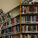 Many of the shelves in the library and classrooms look like this in Napa, Calif. Officials at Napa High School will decide whether classes can resume after cleaning up many of the classrooms Monday August 26, 2014.
