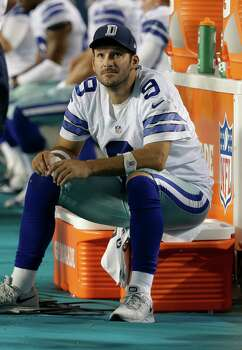 In this Aug. 23, 2014, file photo, Dallas Cowboys quarterback Tony Romo (9) sits on the sidelines during the second half of an NFL preseason football game in Miami Gardens, Fla. If preseason form holds, Romo and the starting Dallas offense won't play in the final tuneup against Denver on Thursday night, Aug. 28.. (AP Photo/Lynne Sladky, File) Photo: Lynne Sladky, Associated Press / AP
