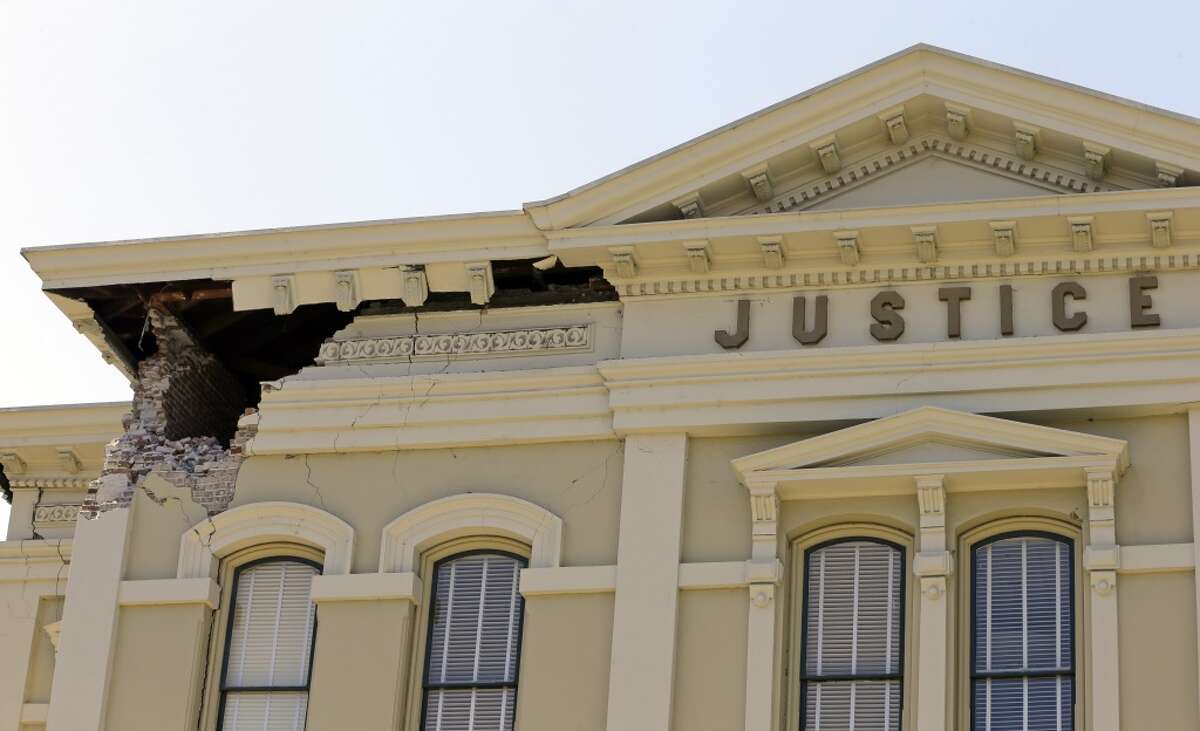 An upper corner of the Napa County Courthouse, where William Roe was imprisoned and later hanged, displays structural damage after an earthquake in 2014.