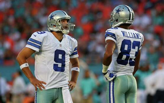MIAMI GARDENS, FL - AUGUST 23:  Tony Romo #9 and Terrance Williams #83 of the Dallas Cowboys looks on during a preseason game against the Miami Dolphins at Sun Life Stadium on August 23, 2014 in Miami Gardens, Florida. Photo: Mike Ehrmann, Getty Images / 2014 Getty Images