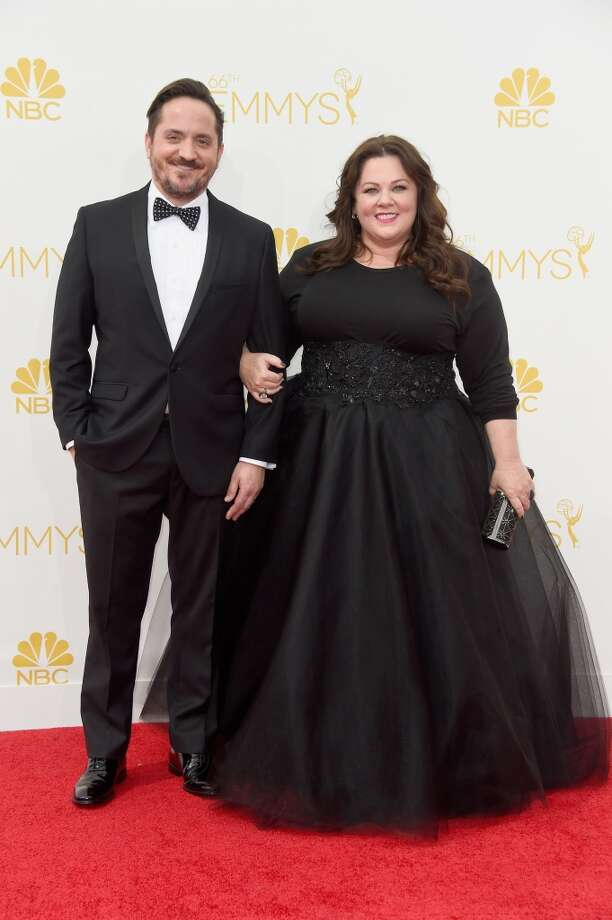 Actors Ben Falcone (L) and Melissa McCarthy attend the 66th Annual Primetime Emmy Awards held at Nokia Theatre L.A. Live on August 25, 2014 in Los Angeles, California. Photo: Frazer Harrison, Getty Images