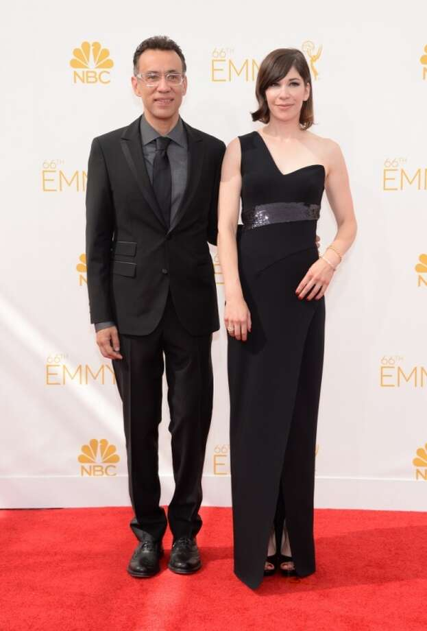 Carrie Brownstein, left, and Fred Armisen arrive at the 66th Primetime Emmy Awards at the Nokia Theatre L.A. Live on Monday, Aug. 25, 2014, in Los Angeles. Photo: Evan Agostini, Associated Press