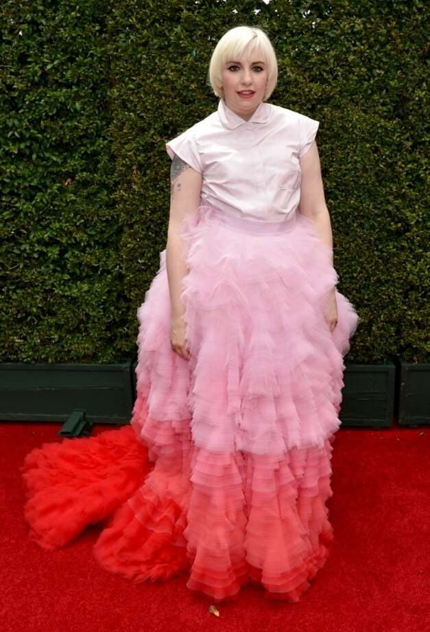 Worst: Oh, Lena Dunham. We love your red-carpet risk taking, but this gown, with its ill-fitting, polo-esque top and too-high-waisted feathery skirt is just too much.  Photo: John Shearer, Associated Press