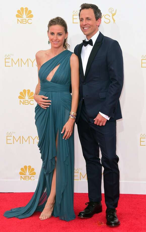 Alexi Ashe and Seth Meyers arrive on the red carpet for the 66th Emmy Awards, August 25, 2014 at Nokia Theatre in Los Angeles, California. Photo: FREDERIC J BROWN, AFP/Getty Images