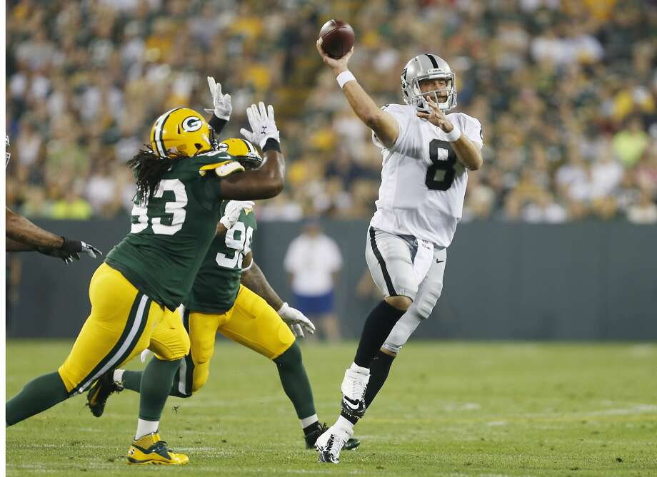 Oakland Raiders quarterback Matt Schaub throws during the first half of an NFL preseason football game against the Green Bay Packers Friday, Aug. 22, 2014, in Green Bay, Wis. (AP Photo/Mike Roemer) Photo: Mike Roemer, Associated Press