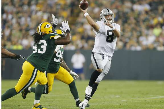Oakland Raiders quarterback Matt Schaub throws during the first half of an NFL preseason football game against the Green Bay Packers Friday, Aug. 22, 2014, in Green Bay, Wis. (AP Photo/Mike Roemer)