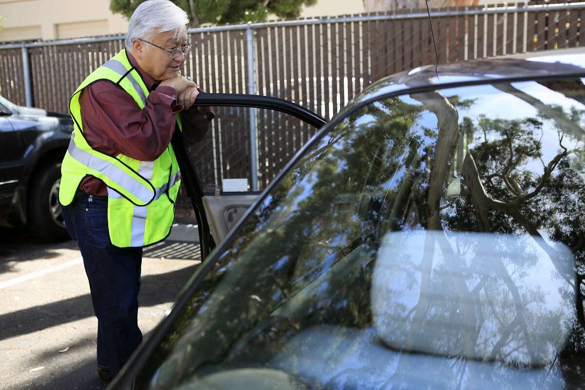 Rep. Mike Honda chats with a person in their car as they leave the Sunnyvale Community Services building in Sunnyvale, CA, Thursday, August 14, 2014.