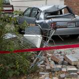 The remains of a home's chimney lays on the ground next to a car it landed on near the corner of Fern Place and Tennessee Street on Monday, August 25, 2014 in Vallejo, Calif.