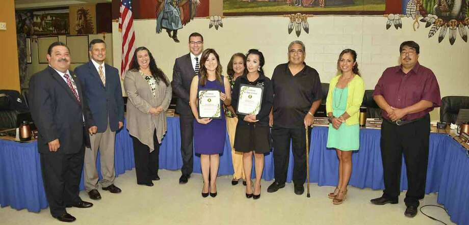The Harlandale ISD Board of Trustees recently recognized LULAC National Education Services Centers' Eloisa Kirkwood as well as Principal Aracelie Bunsen for their support of the Upward Bound Math Science summer. Shown (from left) are: Superintendent Rey Madrigal, David Abundis, Christine Carrillo, Anthony Alcoser, Kirkwood, Velma Ybarra, Bunsen, Jesse Alaniz, Erma Casarez and Juan Mancha. Photo: Courtesy / Harlandale ISD / Harlandale ISD    San Antonio, TX   www.harlandale.net
