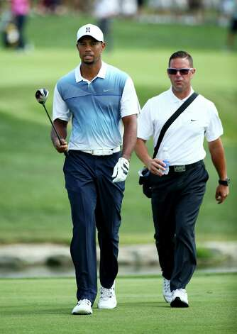 FILE - AUGUST 25:  According to reports, Tiger Woods has parted ways with swing coach of four-years Sean Foley. LOUISVILLE, KY - AUGUST 06:  Tiger Woods (L) of the United States walks with golf instructor Sean Foley (R) during a practice round prior to the start of the 96th PGA Championship at Valhalla Golf Club on August 6, 2014 in Louisville, Kentucky.  (Photo by Andy Lyons/Getty Images) ORG XMIT: 461915367 Photo: Andy Lyons / 2014 Getty Images