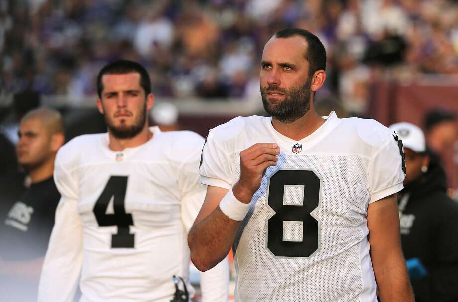 Oakland Raiders quarterbacks Matt Schaub (8) and Derek Carr (4) watch from the sideline against the Minnesota Vikings in the first half of a preseason NFL football game at TCF Bank Stadium in Minneapolis, Friday, Aug. 8, 2014. (AP Photo/Jim Mone) Photo: Jim Mone, Associated Press