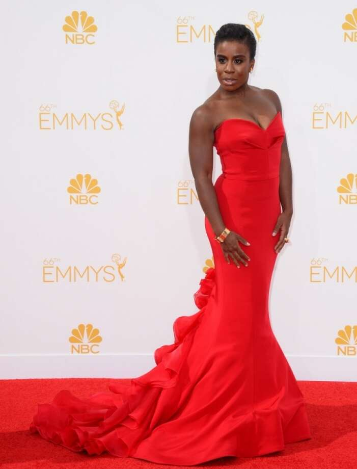 Uzo Aduba arrives at the 66th Annual Primetime Emmy Awards at the Nokia Theatre L.A. Live on Monday, Aug. 25, 2014, in Los Angeles. Photo: Jordan Strauss, Associated Press