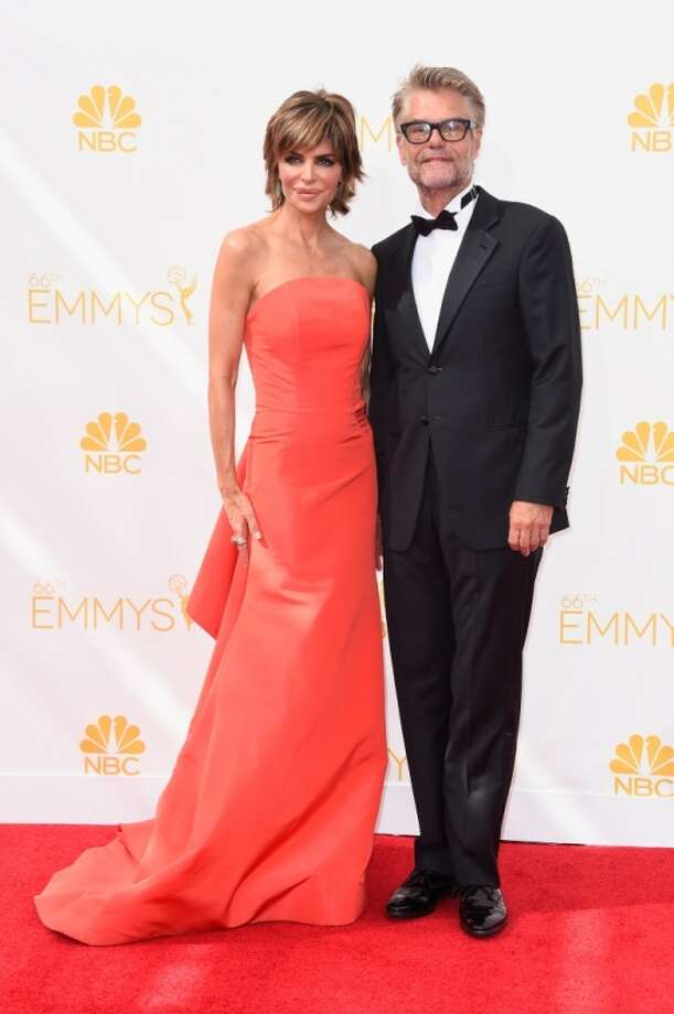Actors Lisa Rinna (L) and Harry Hamlin attend the 66th Annual Primetime Emmy Awards held at Nokia Theatre L.A. Live on August 25, 2014 in Los Angeles, California. Photo: Frazer Harrison, Getty Images