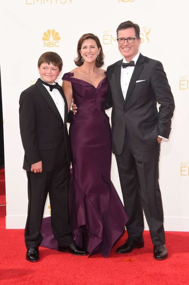 TV personality Stephen Colbert (R), Evelyn McGee-Colbert and son attend the 66th Annual Primetime Emmy Awards held at Nokia Theatre L.A. Live on August 25, 2014 in Los Angeles, California. Photo: Jason Merritt, Getty Images