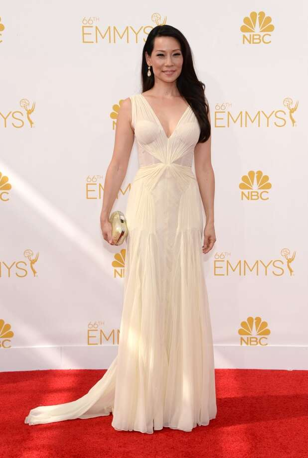 Lucy Liu arrives at the 66th Primetime Emmy Awards at the Nokia Theatre L.A. Live on Monday, Aug. 25, 2014, in Los Angeles. Photo: Evan Agostini, Associated Press