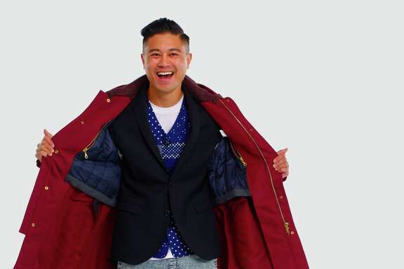 Kevin Gueco layers an American Apparel 50/50 T-shirt with a Sunny Sports kimono vest, Neil Barrett blazer, Kenzo parka. The pants are Zanerobe blonde acid wash, with Y-3 sneakers.