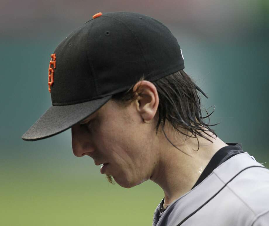 San Francisco Giants pitcher Tim Lincecum walks to the dugout after being removed from a baseball game against the Washington Nationals during the third inning, Saturday, Aug. 23, 2014, in Washington. The Nationals won 6-2. (AP Photo/Luis M. Alvarez) Photo: Luis M. Alvarez, Associated Press