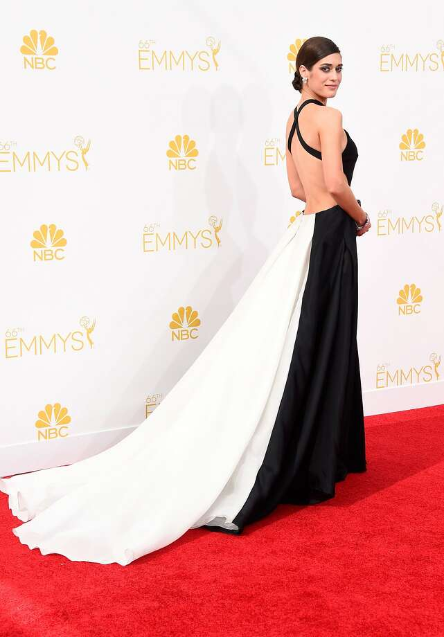 "Hit: Lizzy Caplan, 2014. The ""Masters of Sex"" star was sexy and classy in this black-and-white Donna Karan Atelier gown.  Photo: Frazer Harrison, Getty Images"