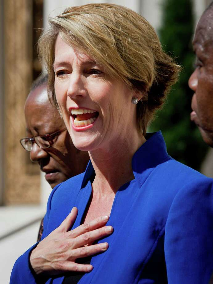 Zephyr Teachout, center, campaigning for the office of New York governor, stands between supporters Bertha Lewis, left, of the Black Leadership Action Coalition, and John Williams, right, with the Seventh Day Adventist Network of Churches, as she speaks during a press conference outside State Supreme Court, Tuesday Aug. 19, 2014 in New York.  (AP Photo/Bebeto Matthews) Photo: Bebeto Matthews / AP