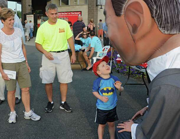 Republican candidate for state comptroller Bob Antonacci, second from left, watches as Christopher Hasselbach, 3, of Slingerlands meets his mascot as he campaigns outside at the ValleyCats game at Joe Bruno Stadium on Monday, Aug. 25, 2014 in Troy, N.Y. Christopher was here with his grandparents. His grandmother Jane McGlynn watches at left. Antonacci is the Onondaga County Comptroller. (Lori Van Buren / Times Union) Photo: Lori Van Buren / 00028324A