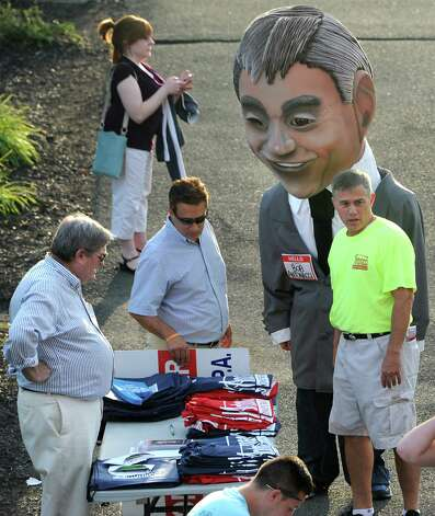 Republican candidate for state comptroller Bob Antonacci, right, campaigns outside at the ValleyCats game at Joe Bruno Stadium on Monday, Aug. 25, 2014 in Troy, N.Y. Antonacci is the Onondaga County Comptroller. (Lori Van Buren / Times Union) Photo: Lori Van Buren / 00028324A