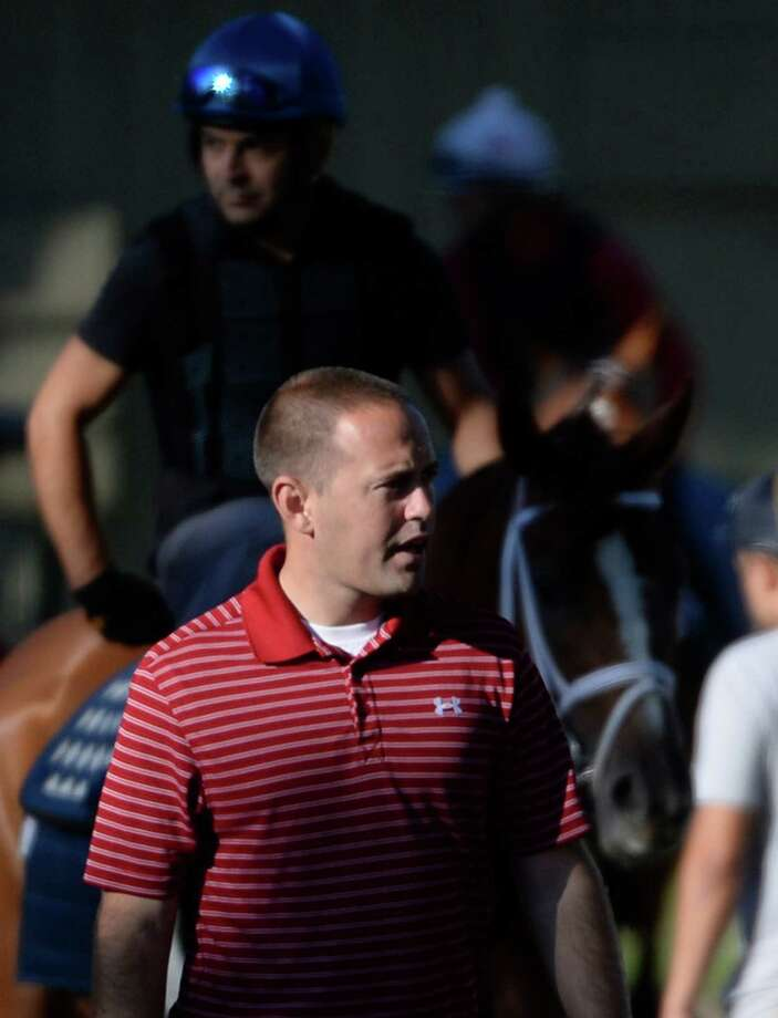 Trainer Chad Brown watches his charges exercise Wednesday morning July 9, 2014 at the Oklahoma Training Center in Saratoga Springs, N.Y. (Skip Dickstein / Times Union) Photo: SKIP DICKSTEIN