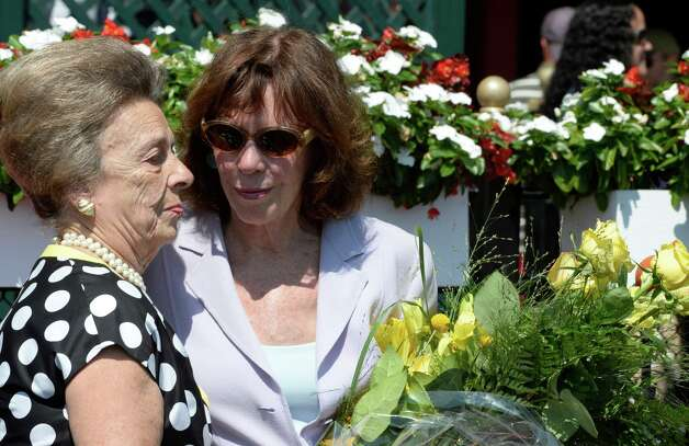 Beverly Steinman, left presents Mrs. Tom Voss with a bouquet of roses in the winner's circle after the 73rd running of the New York Turf Writers Cup Aug, 25, 2014 at the Saratoga Race Course in Saratoga Springs, N.Y.  The race was named in honor of Tom Voss who passed away last winter.    (Skip Dickstein/Times Union) Photo: SKIP DICKSTEIN