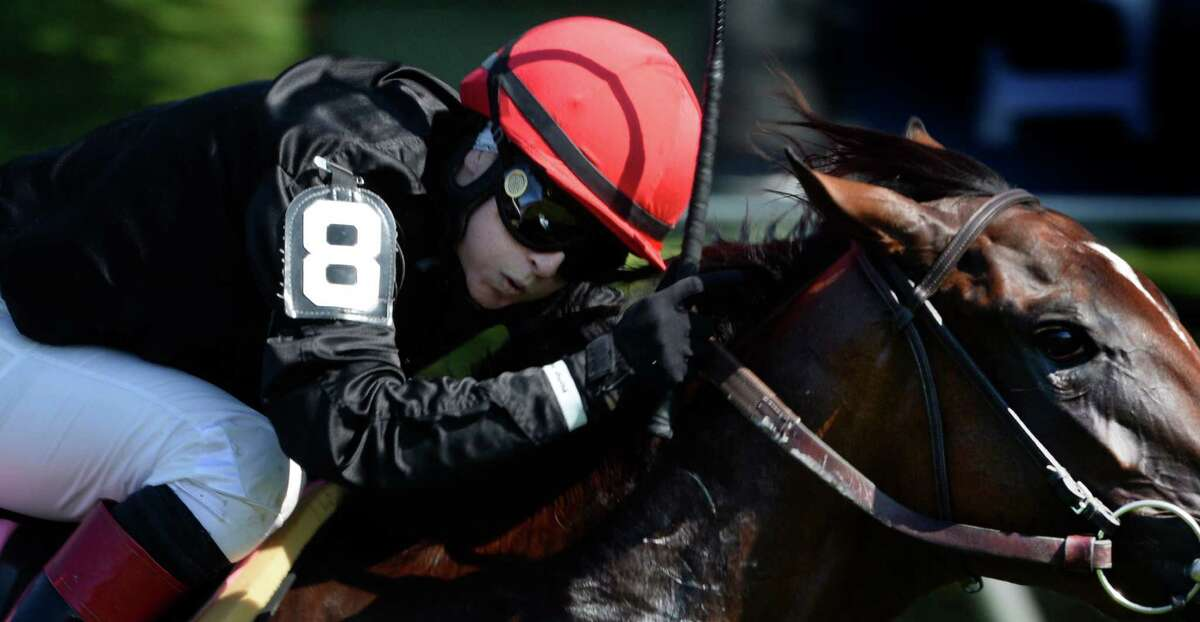 Jockey Rosie Napravnik looks over from her mount Complicated as she was beaten at the wire by Lady Eli ridden by Irad Ortiz Jr. in the 5th race on the card Monday afternoon Aug, 25, 2014 at the Saratoga Race Course in Saratoga Springs, N.Y. (Skip Dickstein/Times Union)