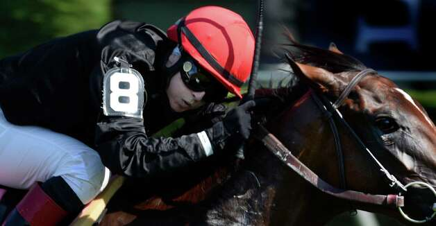 Jockey Rosie Napravnik looks over from her mount Complicated as she was beaten at the wire by Lady Eli ridden by Irad Ortiz Jr. in the 5th race on the card Monday afternoon Aug, 25, 2014 at the Saratoga Race Course in Saratoga Springs, N.Y.  (Skip Dickstein/Times Union) Photo: SKIP DICKSTEIN