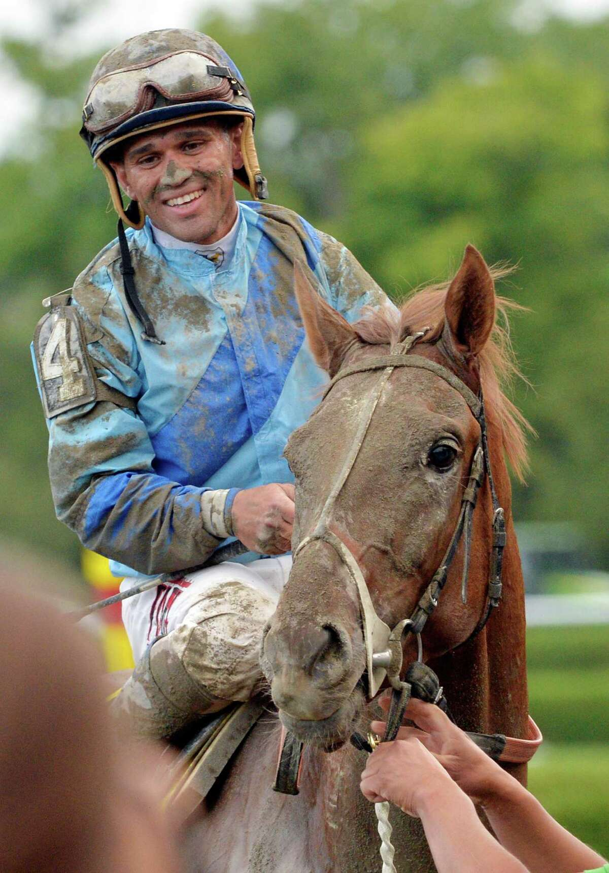 V.E. Day with a very happy jockey Javier Castellano returns to the winner's circle Saturday afternoon Aug. 23, 2014, after winning the 145th running of the Travers at the Saratoga Race Course in Saratoga Springs, N.Y. (Skip Dickstein/Times Union)