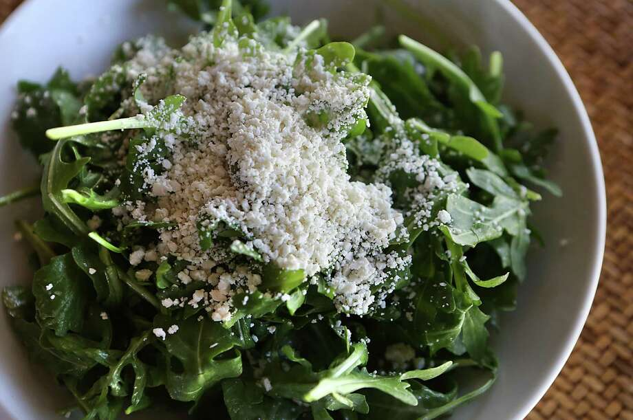 "Arugula (ah-ROO-guh-lah): A salad green with a spicy, bitter flavor. Audio: Click here to hear the term ""Arugula."" Photo: San Antonio Express-News / © 2012 San Antonio Express-News"