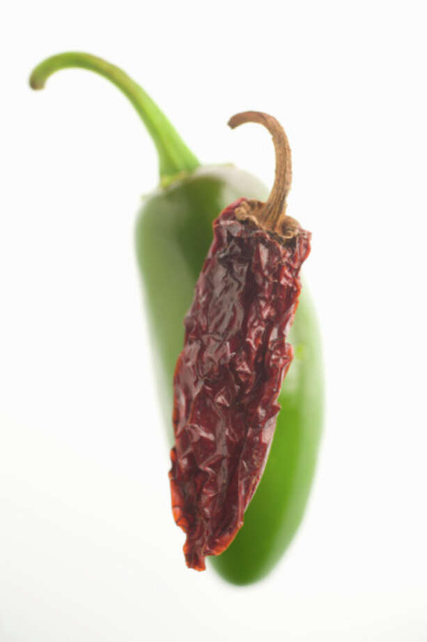 """Chipotle (chi-POHT-leh):Not Chip-ot-el. Before a popular burrito chain made the word popular, it simply meant a dried, smoked jalapeño. Audio: Click here to hear the term """"Chipotle."""" / © 2007 Barry Wong All Rights Reserved"""