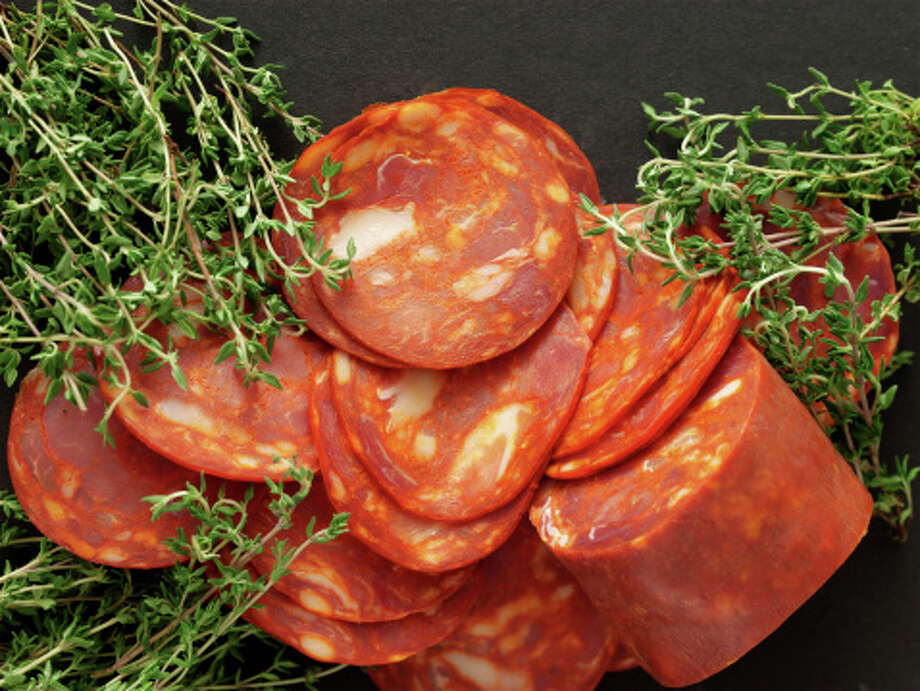 "Chorizo (chor-REE-zoh):A pork sausage that's highly seasoned with chili powder, garlic and other spices. Audio: Click here to hear the term ""Chorizo."" / (c) Chris Ted"