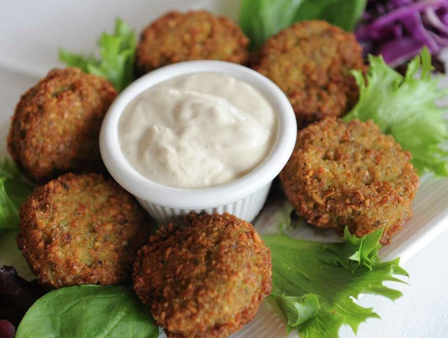 "Falafel (feh-LAH-fehl): Deep-fried croquettes or patties of spiced, ground chickpeas. Audio: Click here to hear the term ""Falafel."" Photo: Lori Van Buren / 00025200A"